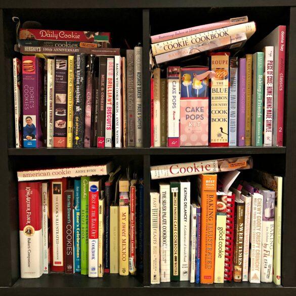 Bookshelf filled with baking cookbooks