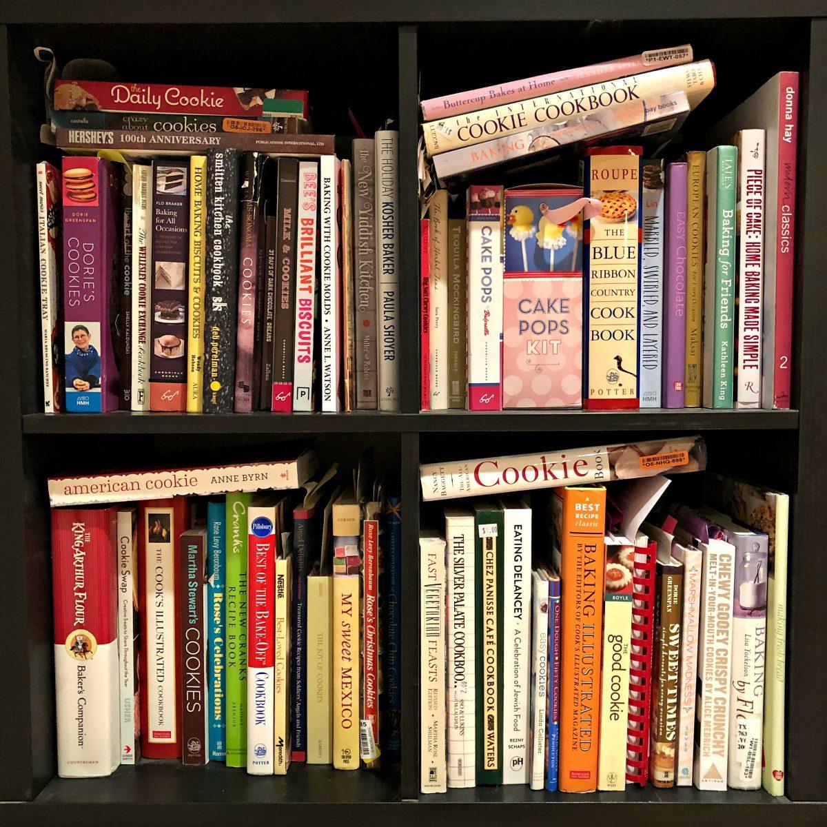 Bookshelf filled with baking cookbooks.