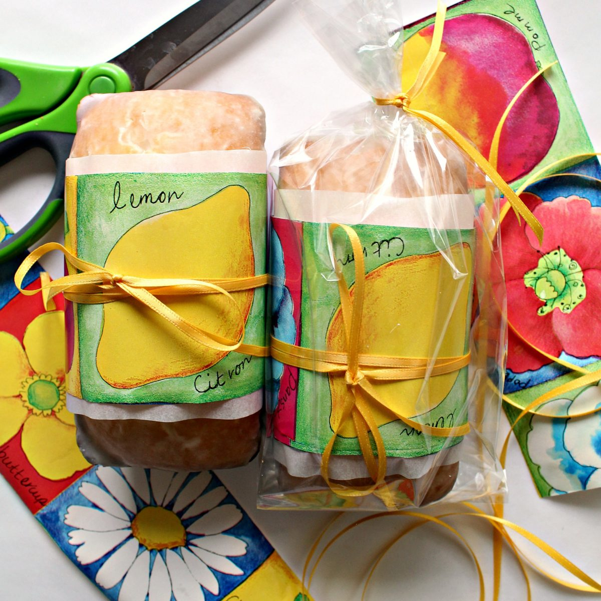 Two Lemon Loaves wrapped for gifting with wrapping paper and ribbon.