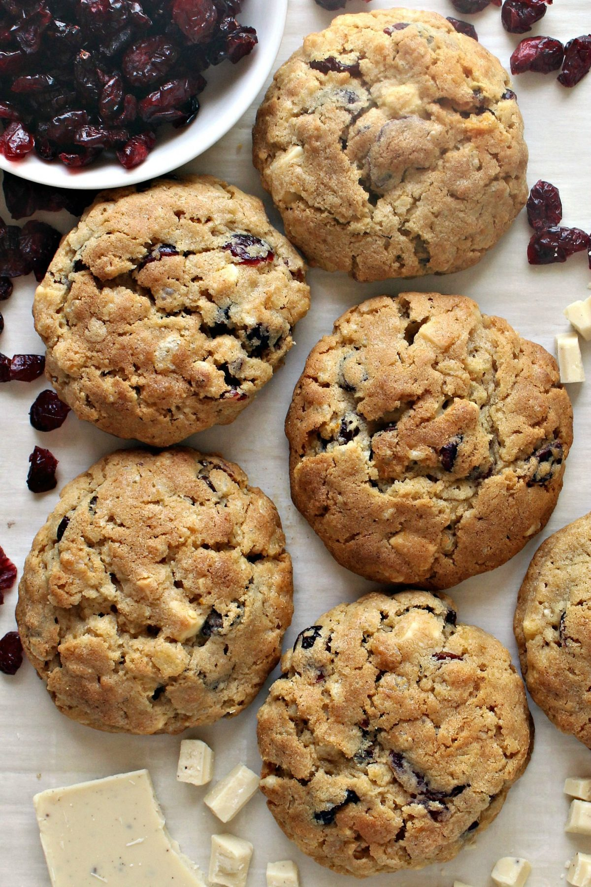 Cranberry White Chocolate Cookies, large and golden brown, with chopped white chocolate and  dried cranberries.