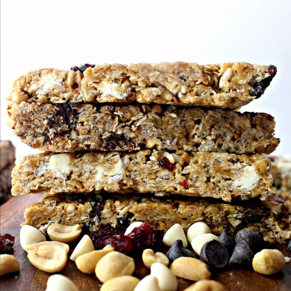 Stack of granola bars showing the cut edges full of cereal and oats.