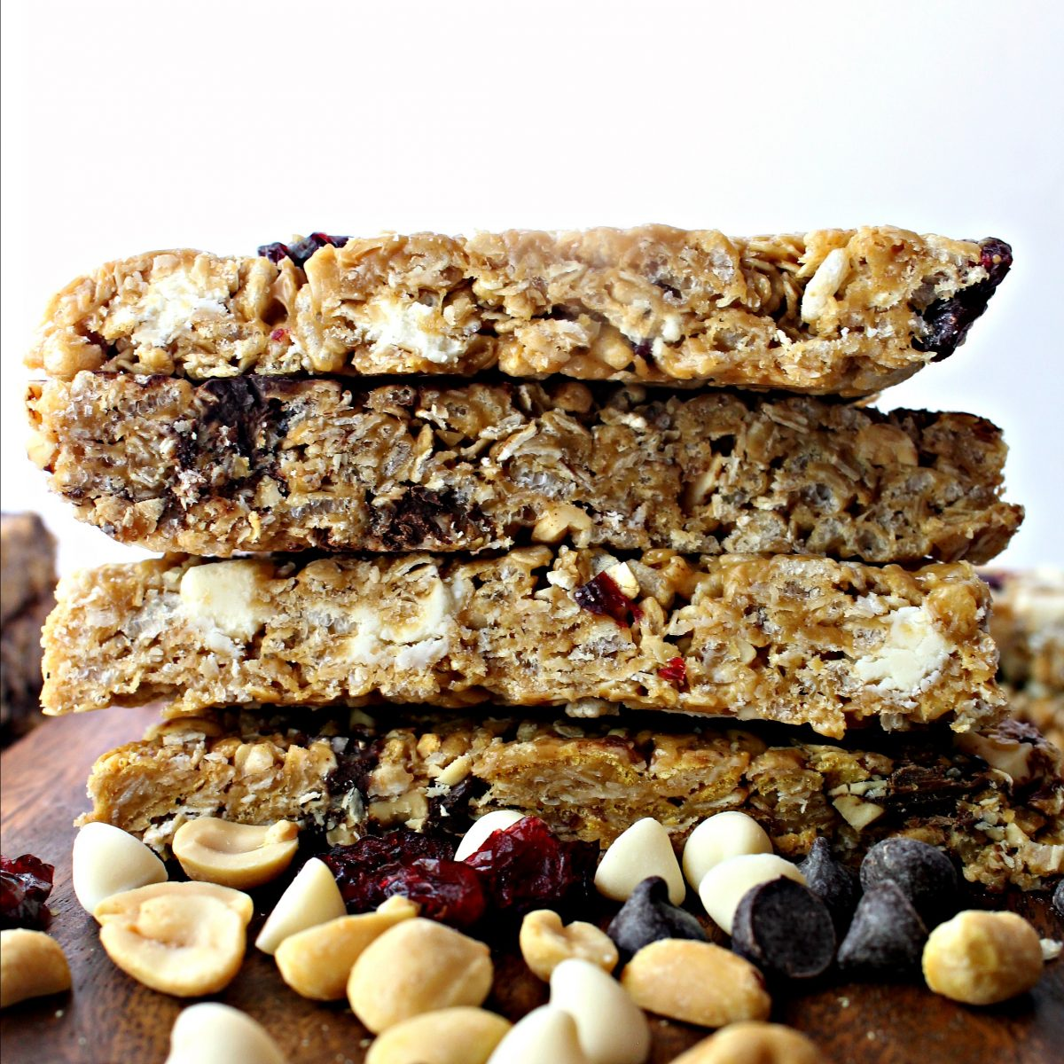 Stack of granola bars showing the cut edges .