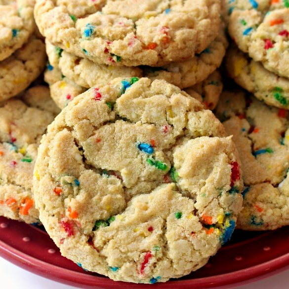 Cookie closeup showing crackled top and bright colored sprinkles.