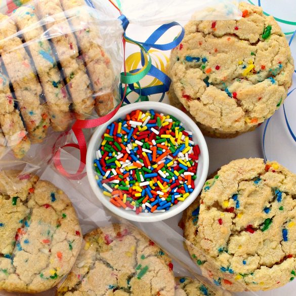 Cookies and a bowl of elongated, rainbow colored jimmies sprinkles.