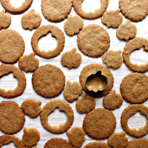 graham cookies with centers being cut out with a pumpkin cookie cutter