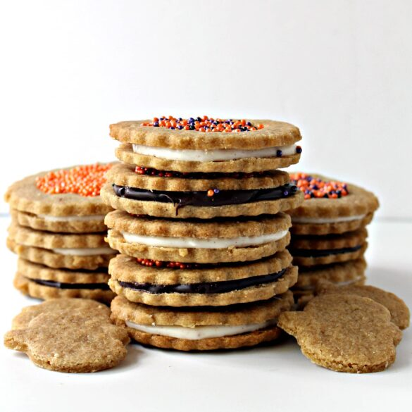 stack of sandwich cookies filled with dark or white chocolate