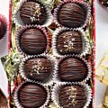 Chocolate covered marzipan balls candy in a gift tin