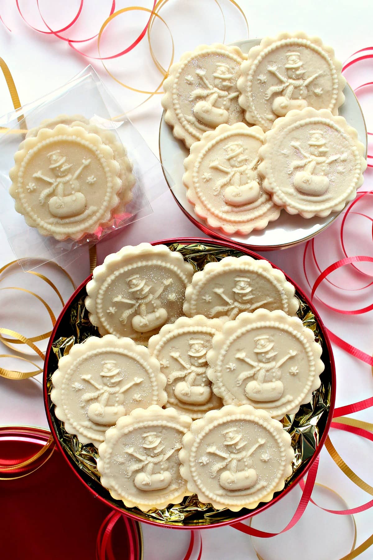 flat discs of Marzipan Springerle Candy imprinted with a snowman cookie stamp