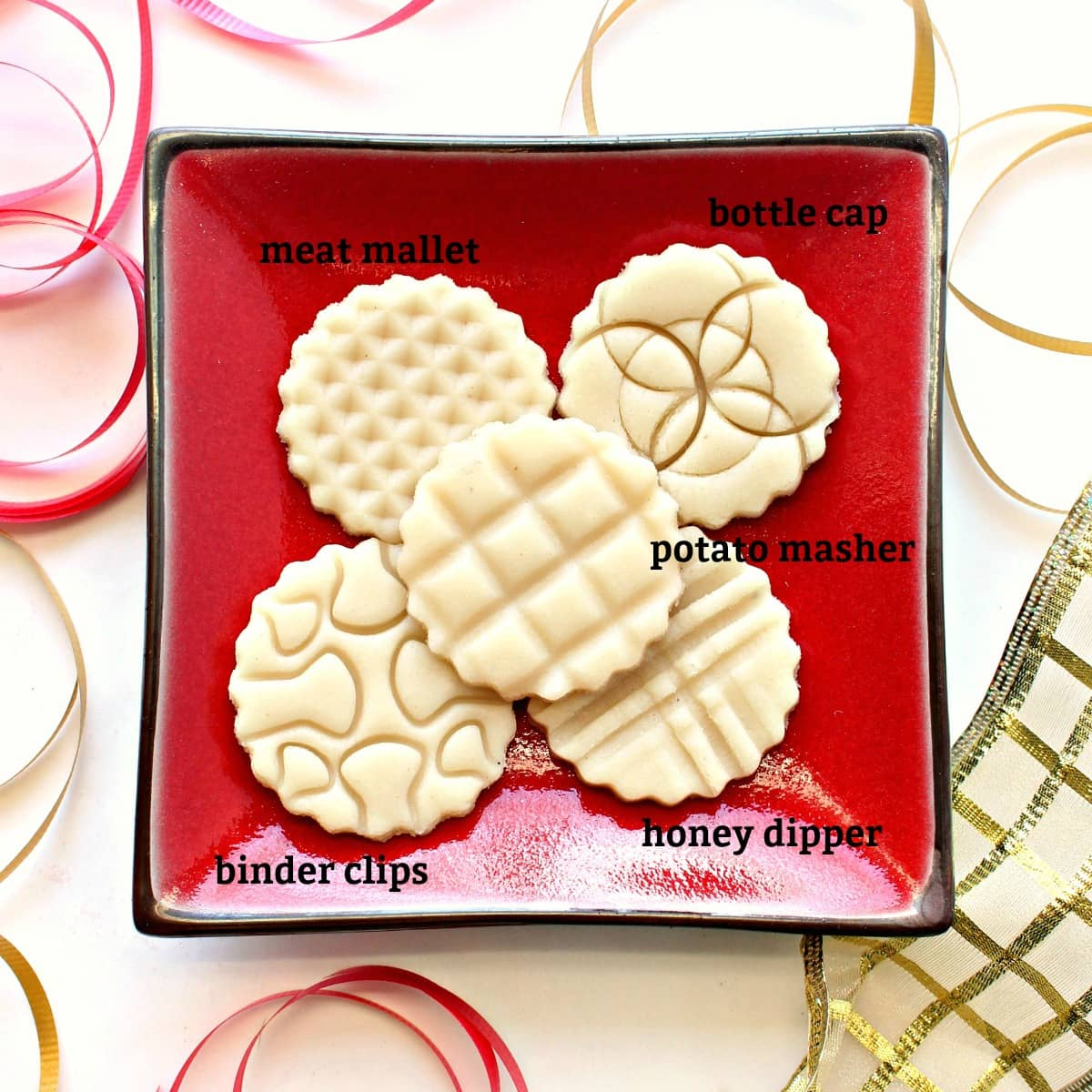 marzipan discs imprinted with designs made with kitchen tools with text labels