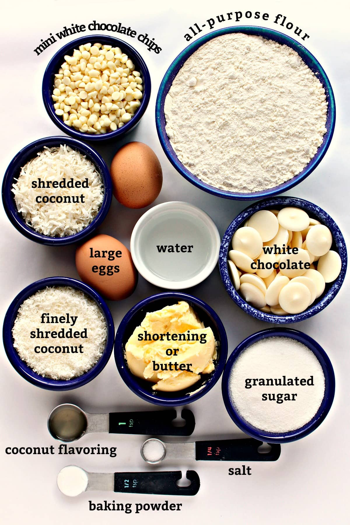 Recipe ingredients with text labels: chips, flour, coconut, eggs, white chocolate, shortening, sugar, baking powder, salt.