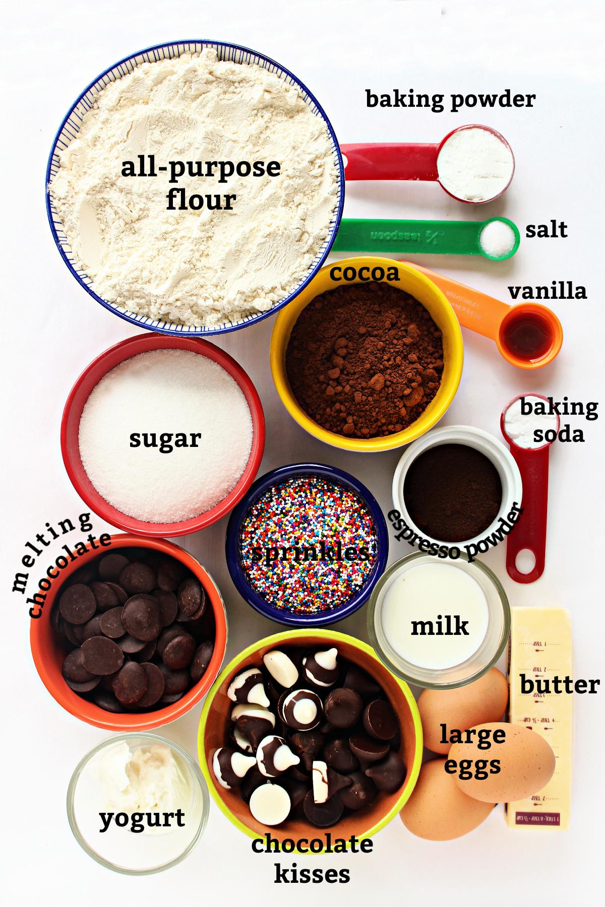 Recipe ingredients labeled flour, baking powder, salt, vanilla, cocoa, baking soda, sugar, eggs, butter, yogurt, chocolate.