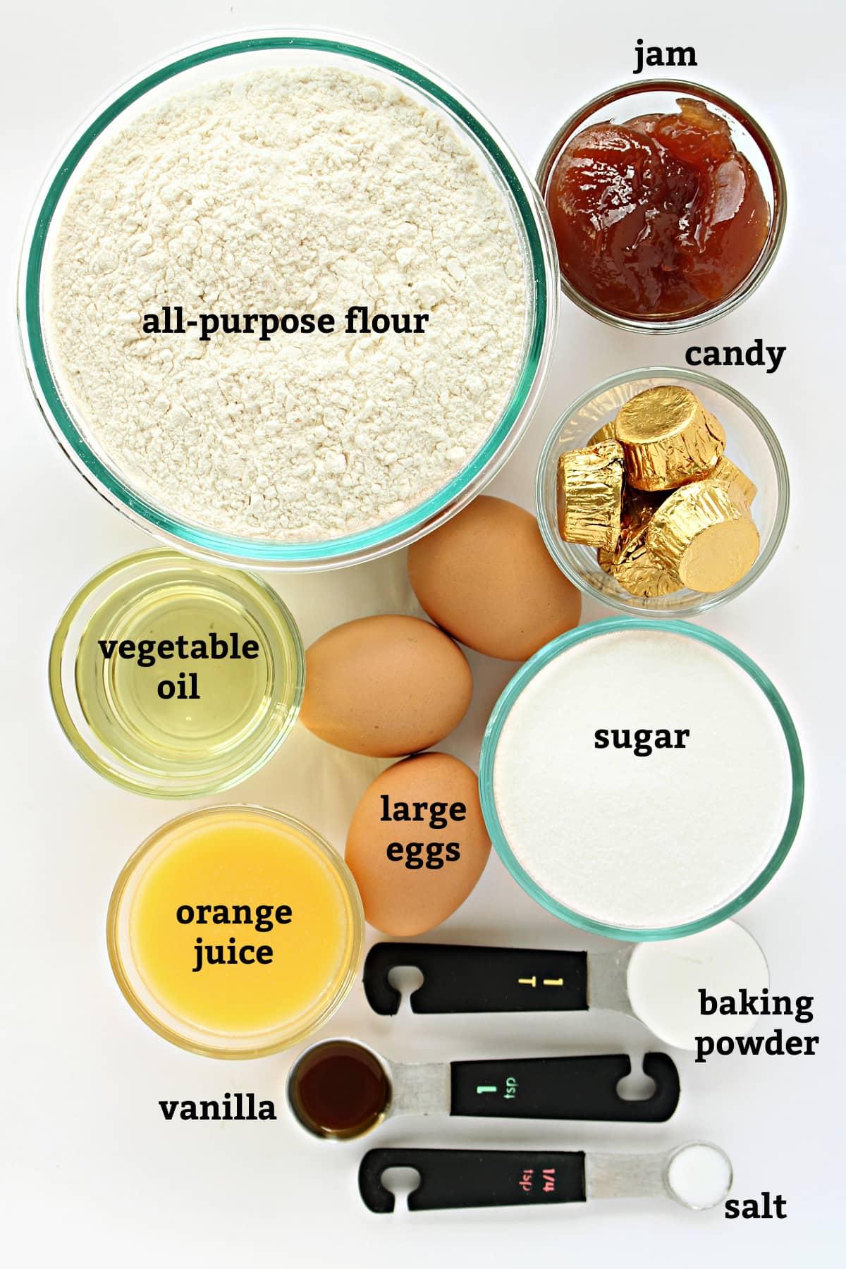 Recipe ingredients with text for jam, candy, flour, oil, eggs, sugar, juice, vanilla, baking powder, salt.
