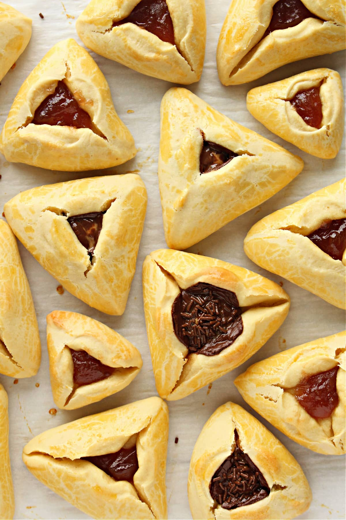 Triangle cookies with filled center pockets with jam or chocolate.