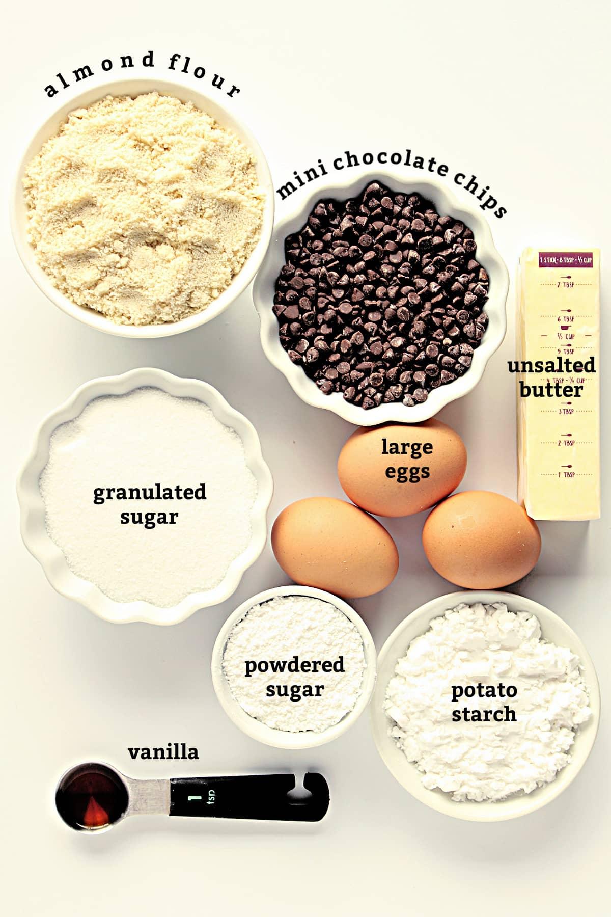Recipe ingredients; almond flour, chocolate chips, unsalted butter, sugar, eggs, powdered sugar, potato starch, vanilla.