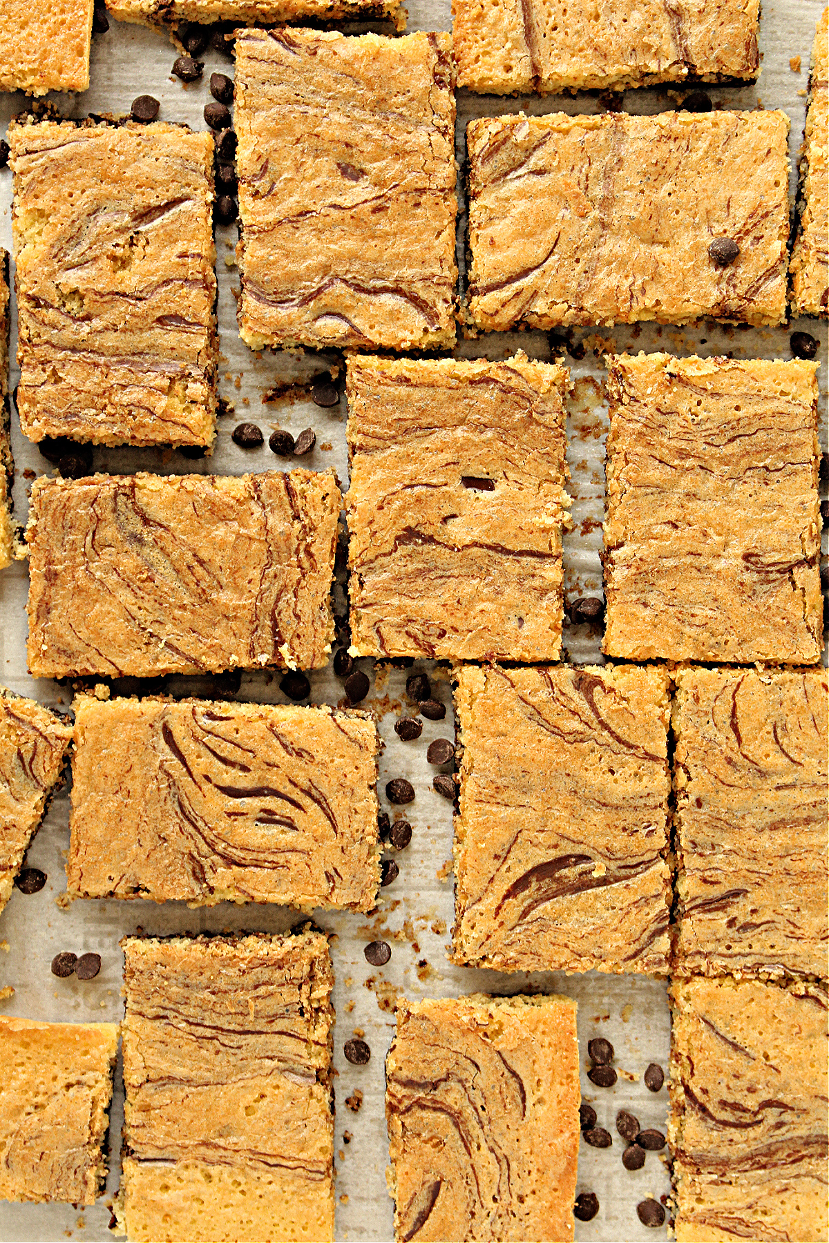 Overhead shot of golden brown cookie bars with swirls of melted chocolate baked in.