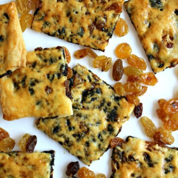Closeup of raisin biscuit squares with golden crust speckled with raisins.