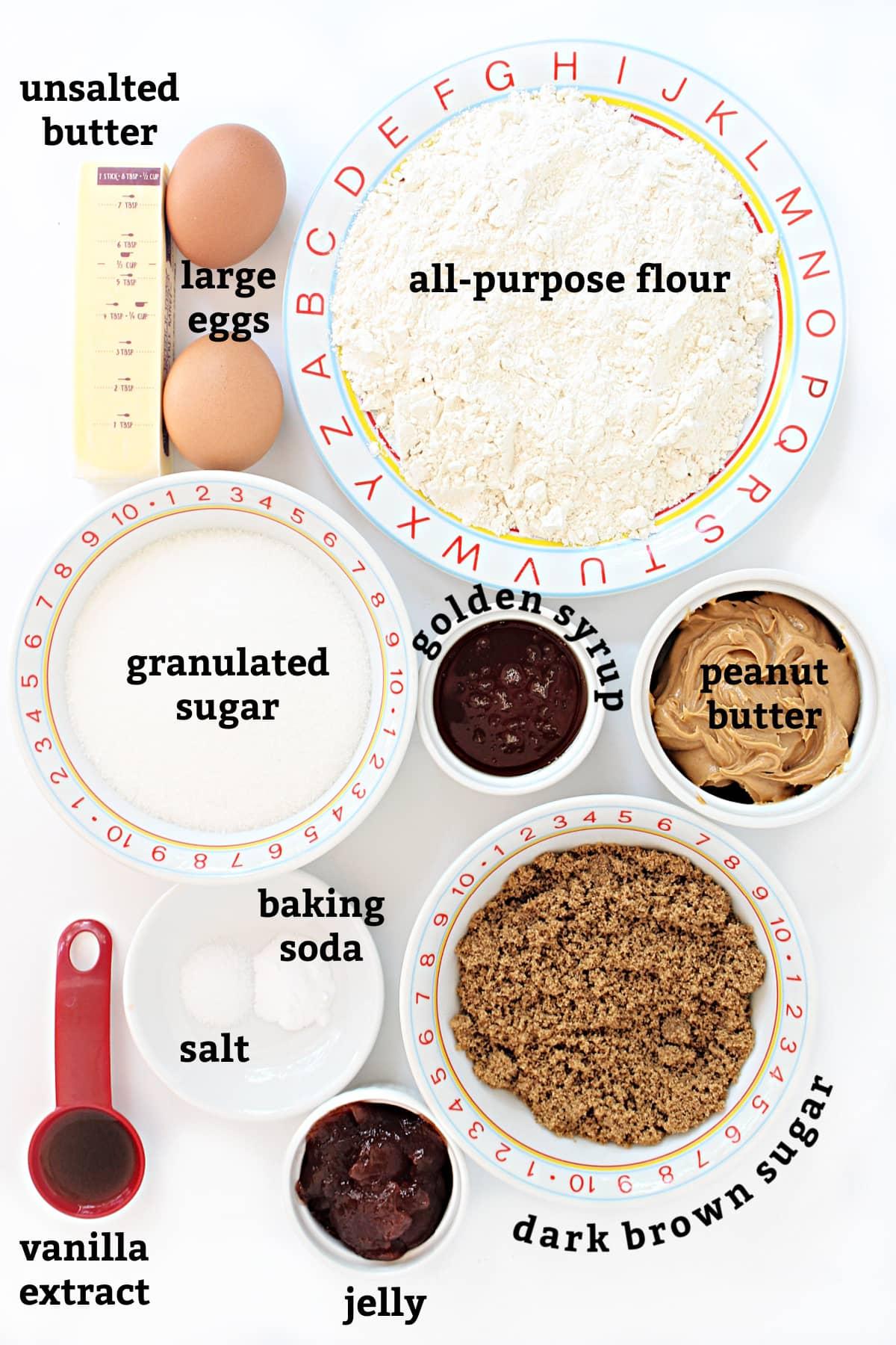 Recipe ingredients: flour, eggs, butter,  sugars, golden syrup, vanilla, baking soda, salt, peanut butter, jelly.
